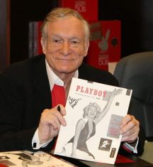 Hef holding the first issue of Playboy.