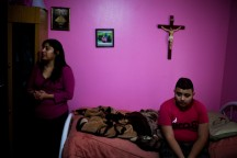 "Leticia Morua stands in her son Jose's bedroom in their Bolingbrook home. She had been placed under deportation proceedings, but then an immigration judge  granted her requests for ""cancellation of removal,"" which makes her a legal resident. Photo by Jonathan Gibby."