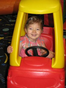 Atia loves scooting around in this little car - 2 y/o.