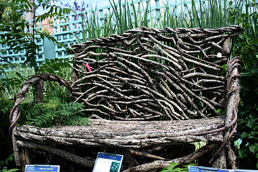 Garden bench made from tree limbs and twigs in Chicago.png