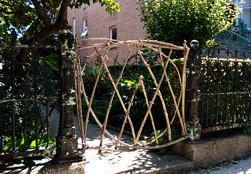 Garden gate in Chicago made from twigs from trees.png