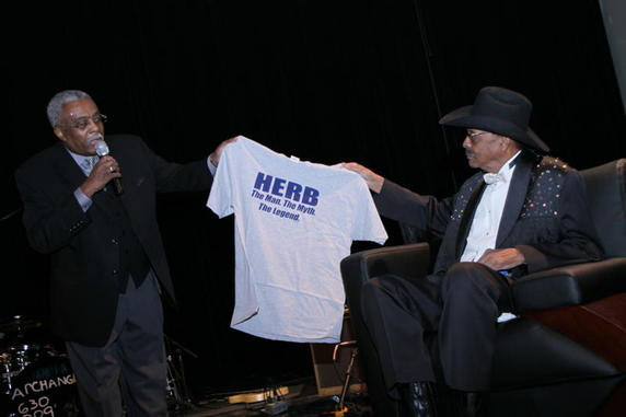 WBEZ DJ Richard Steele presenting Kent with special gift