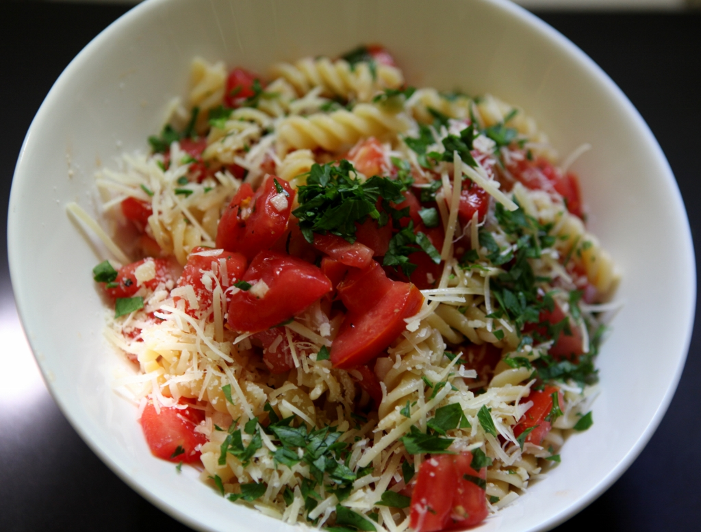 Summer pasta with tomatoes, onion, and garlic