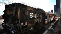 A burned CTA bus sits in the 1400 block of Lake Shore Drive. (Nancy Stone, Chicago Tribune)
