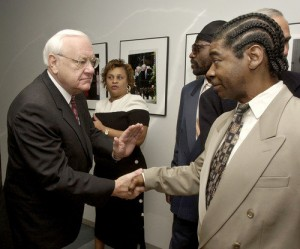 ( Tribune photo by Chris Walker / June 6, 2002 ) At his Thompson Center office in Chicago, Gov. George Ryan, left, pats the hand of Anthony Porter, right, after the two men met for the first time. Ryan had suspended the death penalty in Illinois and Porter was freed from death row after serving time for a murder he didn't commit. But a re-examination of the evidence raises serious questions that Porter might, indeed, be guilty.