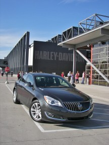 Two iconic American motoring names: the 2014 Buick Regal Turbo at Milwaukee's Harley Davidson museum. <br> <br> 2014 Regal changes are more than skin deep. There's more power, available all-wheel drive, driver's assist suites, improved cabin materials and interfacing technology. <br> <br> Starting at $33,300, our Smoky Grey Metallic front-drive tester with Premium II feature set rang in at $38,270. Now laying down the gaunlet to premium European and Asian executive sporty sedans.<br>