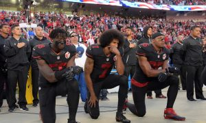 Oct 6, 2016; Santa Clara, CA, USA; San Francisco 49ers outside linebacker Eli Harold (58), quarterback Colin Kaepernick (7) and free safety Eric Reid (35) kneel in protest during the playing of the national anthem before a NFL game against the Arizona Cardinals at Levi's Stadium. Mandatory Credhttp://www.chicagonow.com/hot-dog-diaries/?p=661&preview=true&url=post/preview/661it: Kirby Lee-USA TODAY Sports