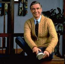 Here Mr. Rogers is in all his glory -- zipper cardigan, loafers and sneakers, tie and all.  I always wanted to give him a hug.