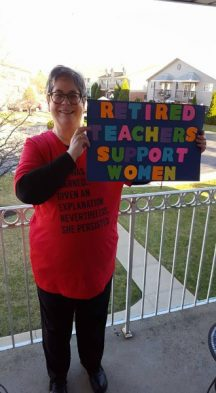 I decided to make a sign mentioning my former teaching experience and not quilting. I also wore a red t-shirt and coat.