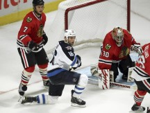 Blackhawks overcome slow start to down Jets