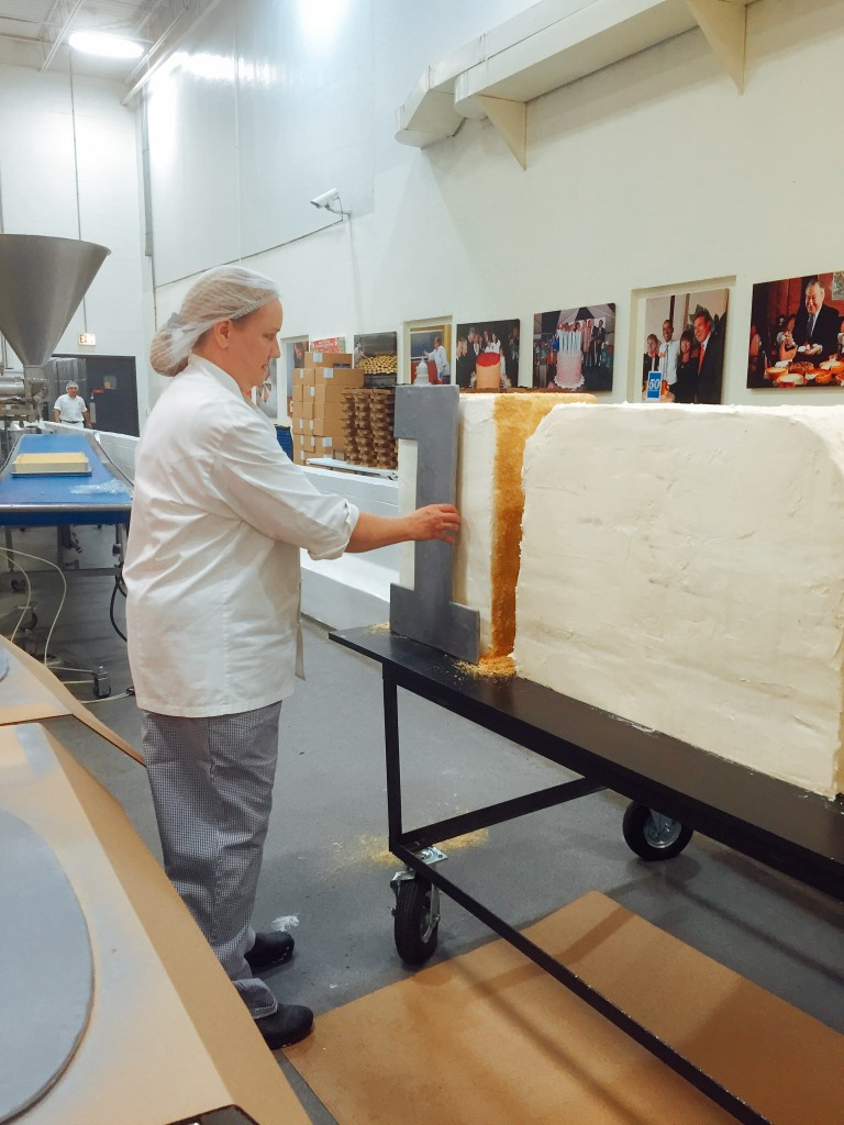 Workers at Eli's getting the 1000lb. Cheesecake ready for Navy Pier's 100th Anniversary