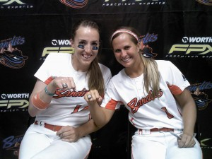 Olympian Monica Abbott and Amanda Williams of the Chicago Bandits show off their 2011 NPF Championship rings. They're hoping for another in the 2013 NPF games, starting August 22.