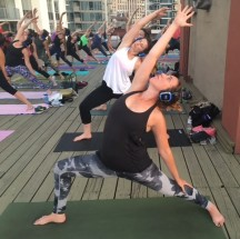 Rooftop yoga while wearing headphones